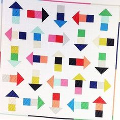 fresh and modern arrow quilt made from only solids