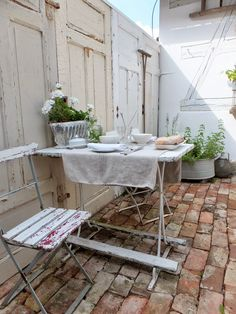 Worn brick patio with vintage finds - princessgreeneye Outside Living, Outdoor Living, Bistro Chairs, Brick Patios, Old Doors, Outdoor Spaces, Outdoor Gardens, Interior Decorating, Sweet Home