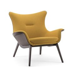 cbe05f88cb7 The Nirvana lounge chair has a wooden frame and a upholstered seat and  back, this
