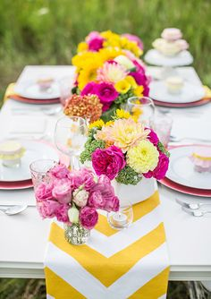 Wow, these colours really hit you...but in a good way. bold pink and yellow is a fresh and fun combination and the multitude of florals make this table setting really chic.   www.trixandtrumpet.com