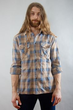Untucked flannel with dark pants.