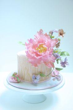 A dramatic sugar peony cake