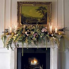 Not all Decorated Mantels have to be a Bright Red and Green::This Lush mix of Shades of Green with Touches of Pink and Gold is very Elegant.