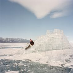 Celebrating Mongolia's Beautiful, Brutal Winter Cold | Khovsgol, Mongolia, February 2013. A woman slides down an ice ramp, made for the Ice Festival on the frozen lake of Khovsgol, the day before the festival started.  Chiara Goia  | WIRED.com