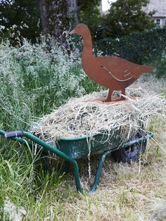 A delightful new addition to our rusty red family, this troublesome goose has laser cut details and a handy flat base to keep him grounded In the garden. This grand goose will rust further if left outside, enhancing the appearance and adding to his charm.