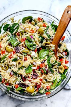This vegetarian Mediterranean orzo pasta salad with crunchy vegetables and spinach, briny olives, and feta cheese makes a healthy, easy-to-make, meal-prepped meal or flavorful pasta salad side. Get the recipe: Mediterranean Orzo Salad Salad Recipes For Dinner, Healthy Salad Recipes, Orzo Salad Recipes, Healthy Salads For Dinner, Super Healthy Recipes, Vegetable Pasta Recipes, Food Salad, Dinner Salads, Orzo Pasta Salads
