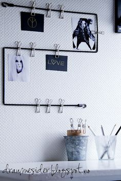 Stretch a bungee cord into a geometric pattern on your wall and add stainless clothesline clips for an adjustable wall organizer and display. | 35 Brilliant Ways Bungee Cords Can Solve All Your Problems