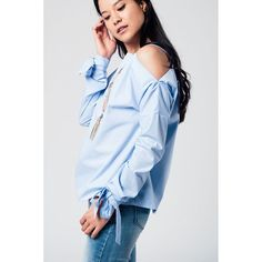 39fa35dbe25e Cold shoulder blue shirt with laced cuffs