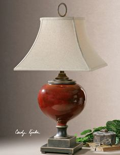 Lightly Distressed Burgundy Ceramic with Heavily Antiqued Dark Bronze Accents from Uttermost