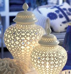 Plantation Home Accessories have a beautiful Moroccan style decorative pierced porcelain vase lantern / candle holder.