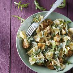 Pasta met champignons en rucola