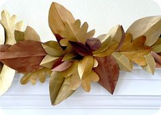 "painted leaves from paper bags. Here on the mantel. Also good as a table decoration . . . use extra ""leaves"" as place cards."