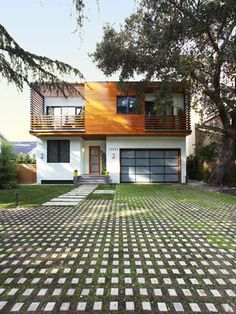 Green driveway - great for absorbing water or run off, adds a soft element to the home exterior