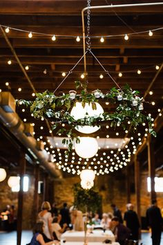 Bistro Lights and Greenery Chandeliers    #wedding #weddings #weddingday #realweddings #weddingideas #southernwedding #greenery #industrialwedding #industrial #warehouse