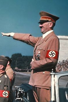 Hitler perfects salute! / Hat Brigade hunts for huge hoard of Hitler-hats! No luck yet.