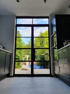 with French doors, design, and light combined to create a unique look for a quaint kitchen. Our steel look doors replicate the but in aluminum to meet current building regs Aluminium Door Design, Aluminium French Doors, Crittal Doors, Aluminium Kitchen, Crittall, New York Loft, French Doors Patio, Kitchen Doors, Single Doors