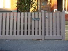 modern picket fence and gate a lovely colour.