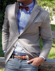 Light grey sport coat, blue plaid shirt, red bow tie, jeans