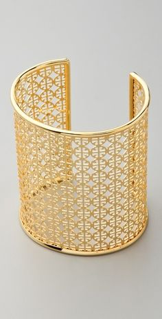 this Tory Burch cuff is ultra-modern, yet has a retro-vibe! perfect to spruce up any summer ensemble!