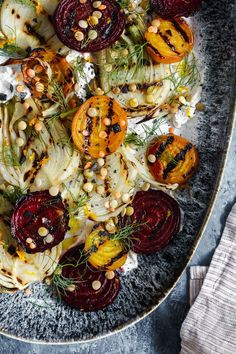 This hearty and flavorful grilled beet and fennel salad with sprouted lentils is accented with a schmear of plant-based orange and cumin scented yogurt. #vegan #fennel #beet #salad