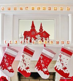 Red and white Christmas mantel.  Cute idea for an advent calendar.  A votive for each day of December leading up to Christmas.