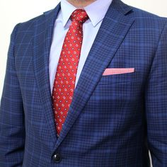 A red gingham pocket square to complement your outfit