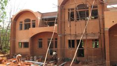 I love arched windows. Built with stabilized compressed earth blocks (CEBs).