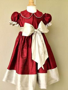 Girls custom silk dupioni dress with ruffle trimmed sleeves and large bow/sash. Free matching bow. Two colors of your choice.