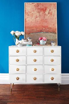 Lacquered Regency Twelve Drawer Dresser -  back is finished - glossy-smooth lacquer finish, brass & lucite hardware & legs -- anthropologie.com