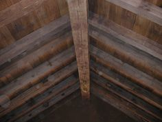 Wormy Chestnut Barnboard Ceiling and Hand Hewn Rafters - Montana Reclaimed Lumber