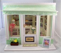 www.mumandmeminiatures.com.au  Hand made 1:12 scale Cake Shop Box filled with miniature cakes and accessories. Available through Mum & Me Miniatures