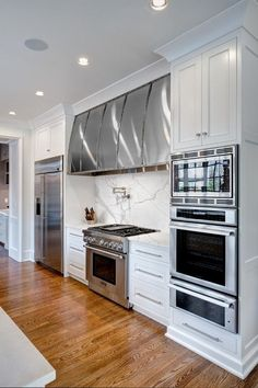 Andrew Roby General Contractors, Charlotte, NC. Love the microwave convection oven, wall oven and warming drawer design.