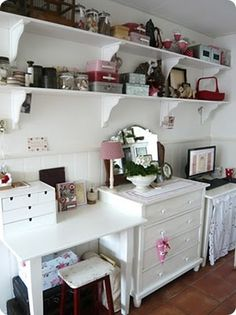 Craft room (Lovely, except for that stool.  That could interrupt anyone's creative attitude.)