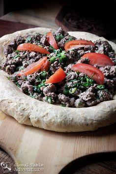 "Saudi Lamb ""Pizza"" | Aysh abu Laham Saudi Arabian Food, Nigella Seeds, Dough Ingredients, Ground Lamb, Middle Eastern Recipes, Arabic Food, International Recipes, Easy Meals, Recipes"