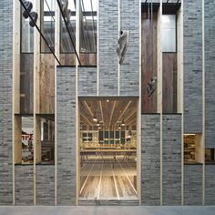 An old brick and timber house appears to have been cut in two inside the new Shanghai flagship store for shoe brand Camper, designed by Chinese architects Neri&Hu