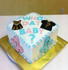 New Orlean's Saints themed Gender Reveal Baby Shower Cake - It was blue on the inside! Fun cake to make!