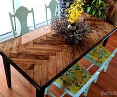 We'll teach you how to build this fabulous herringbone table, complete with glossy epoxy and tapered legs. Love this wooden dining table! {Reality Daydream}