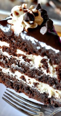 Cookie Dough Brownie Cake Recipe ~ Rich and decadent, this three-layer brownie cake is filled with cookie dough frosting and topped with a silky chocolate ganache.