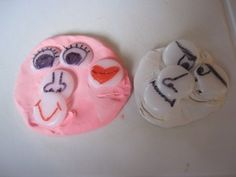 How simple, why didn't I think of this?  Draw on plug protectors and you can make faces with play dough with the kids!