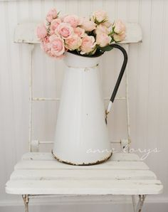 What could be prettier than a profusion of roses in a simple white vintage enamel pitcher.