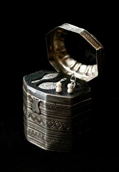 Miniature solid silver ladies vanity case Contains a small hair brush and hand mirror along with a small perfume bottle and two hand carved ivory implements dimensions are 1¾'' height by 1½'' width and 1¼ in depth.