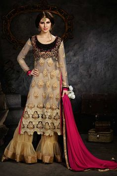 Grey Net Trouser Suit With Dupatta Grey Net, semi stictch trouser suit. Allover embroidered with embroidered, resham, zari and stone work. Round neck, Below knee length, full sleeves kameez.  Beige santoon trouser.  Pink chiffon dupatta.
