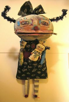 Monster art doll with dolly pin .....I added a monster dolly in her pocket ..... it is a pin { brooch } Sandy Mastroni