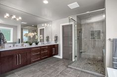Contemporary Master Bathroom with slate tile floors, specialty door, Wall sconce, Double sink, Undermount sink, Rain shower