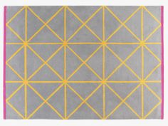GRID Bright and bold Grid geometric patterned woollen rug in grey with contrasting yellow grid lines and a striking cerise pink border.