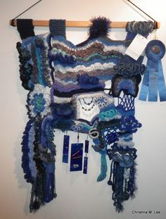 """Free Form Crochet Wall Hanging with Blue Ribbon and note from the Judge which says, """"Beautiful & Very Original."""""""