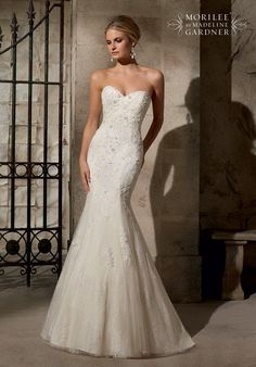 Mori Lee Bridal Gown by Madeline Gardner, Style 2713, $1275, Sz. 22, This is a s fully laced mermaid gown. The bodice features a classic sweetheart neckline. The back features a sheer lace piece. Call us for your Consultant Appointment at Debra's Bridal Shop at The Avenues, 9365 Philips Hwy., Jacksonville, FL. 32256, (904) 519-9900