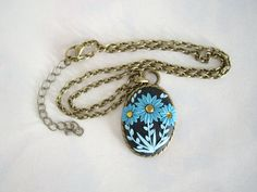 Polymer clay nacklace, Polymer clay floral necklace, Blue floral nacklace, Black cabochon necklace, Blue daisy pendant, Handmade necklace by MisakoBeads on Etsy