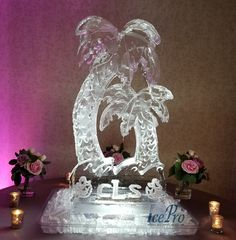 Double palm tree ice sculpture created from a full block of ice. A monogram is etched into the ice at the base of the sculpture. Ice Sculpture Wedding, Snow Sculptures, Snow Globes, Palm, Wedding Decorations, Monogram, Create, Wedding Decor, Monograms