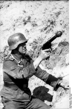 "Oberfeldwebel from Division ""Großdeutschland"" with a grenade launcher pistol (Kampfpistole and Wurfkörper 361 LP). Russia June 1943"